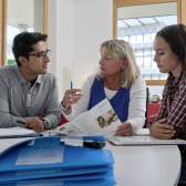 Two students and a consultant during a consultation.